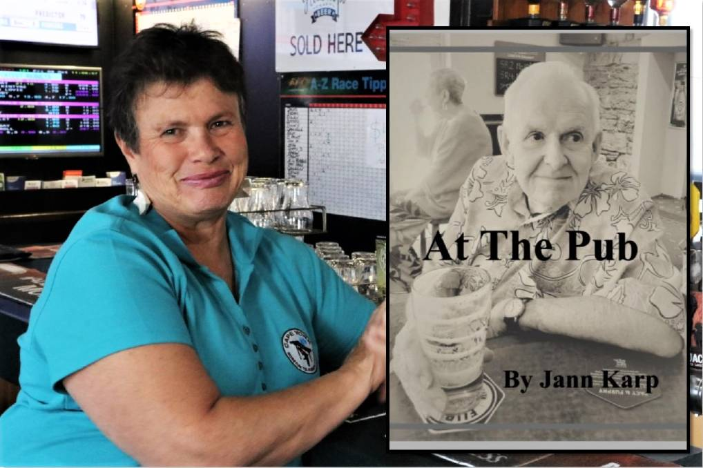 Jann Karp in her local pub the St Kilda in Armidale with her latest book poster. Photo: Kathy Ewers