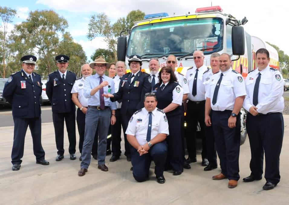 PARK HER OUT THE BACK: Handing over the keys to the fire tankers worth $780,000 on Sunday. Photo: supplied.
